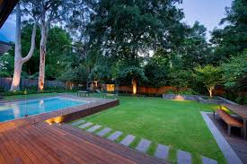 Contemporary Backyard Ideas Elegant Wooden Desk And Concrete Walkway Using Small Swimming Pool