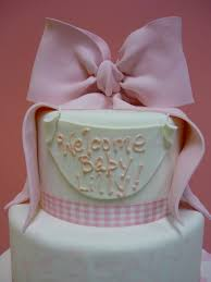 artisan bake shop baby shower cake top cake and bow