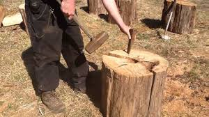 using wood splitting firewood using wedge sledgehammer