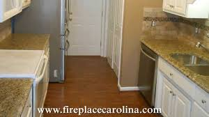what color cabinets go with venetian gold granite new venetian gold installed on white cabinets 11 21 13