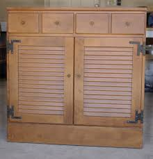 brown polished kitchen cabinet with beadboard shutter door panel