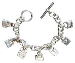 sterling silver bracelet with charms images Herm s silver rare sterling bags charm bracelet tradesy jpg