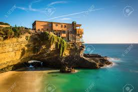 long exposure of a house on a cliff and a small cove at table