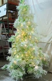 sterling 4 ft pre lit lightly flocked pink keystone pine