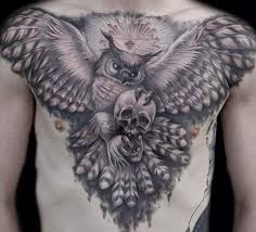 great flying owl with skull and masonic symbols tattoo on chest