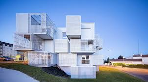 a new social housing project made of stack of metal boxes offers a