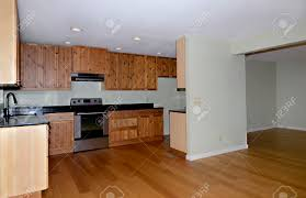 view of a kitchen and dining area with knotty pine cabinets and
