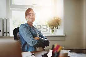 femme bureau enthusiastic with smile and eyeglasses working at bright