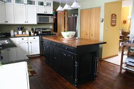 l shaped kitchen design featuring black kitchen island with