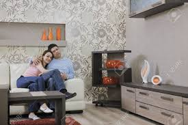 happy young couple relax at home in modern and bright living