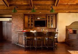 mediterranean basement wine bar room with brick wall also hardwood