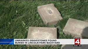 several unmarked gravestones found buried in downriver backyard