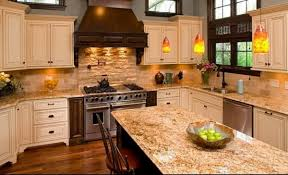 attractive kitchen cabinets with light countertops from