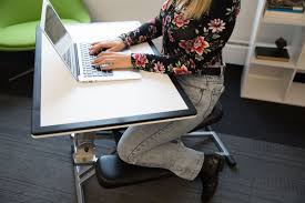forget standing kneeling desks should be the new office trend