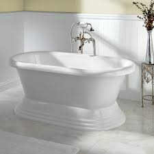 bathroom wainscoting and accent table with freestanding bathtub