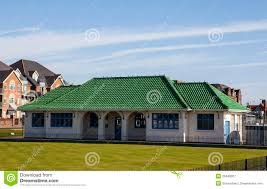 green roof tiles bowling clubhouse with vivid green roof