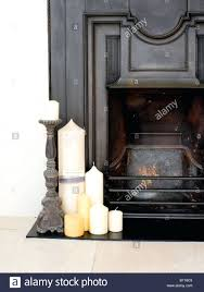 candles fireplace decorating ideas metal candle holders close