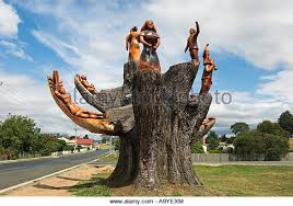 wood carving in dead tree stock photos wood carving in dead tree