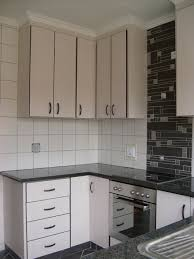 mitre 10 kitchen cabinets built with black cherry wrap our work kitchen cupboards