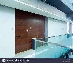 view of a wooden partition against a corridor stock photo royalty