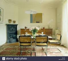 modern chrome cane chairs in french townhouse dining room with