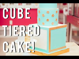 cake how to how to make a fancy tiered cube cake with blue and fondant