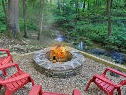 Northwest Territory Fire Pit - cozy log cabin on stream with fire pit vrbo