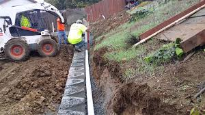 adding drainage pipe u0026 drain rock to retaining wall youtube