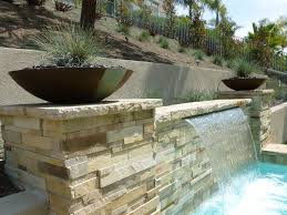 contemporary landscape and yard with pool waterfall feature by rue