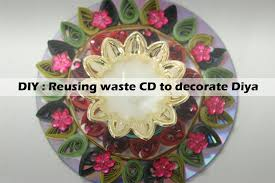 diy reusing waste cd to decorate diya thalagiri
