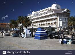 out of season view of hotel baia with closed souvenir stalls stock