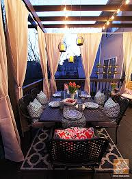 deck decorating ideas pergola lights and cement planters