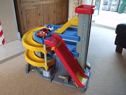 large fisher price big action toy garage with lift ramps cars