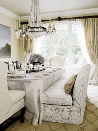 dining room table with sofa seating cozy up to a loveseat at the