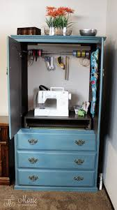 Computer Armoire With Pocket Doors by Compact Armoire Sewing Closet