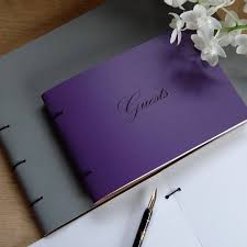 purple guest book personalised leather guest book by artbox notonthehighstreet