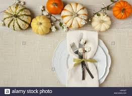 fall autumn festive table setting place setting with pumpkins