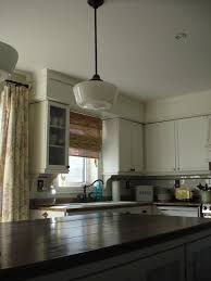 Area Above Kitchen Cabinets Closing The Space Above Kitchen Cabinets The Turquoise Home