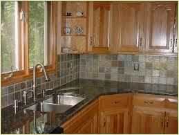 granite countertops for white cabinets stainless steel tile edging
