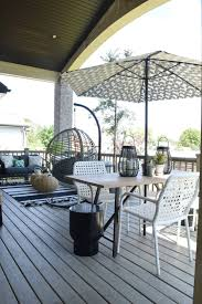 outdoor patio and living space with hanging chair nesting with grace