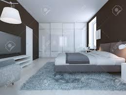 spacious bedroom minimalist style dark brown walls dressed