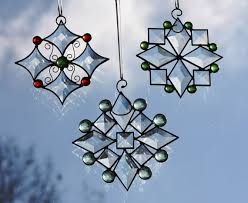 beveled stained glass snowflake with pale green jewels suncatcher