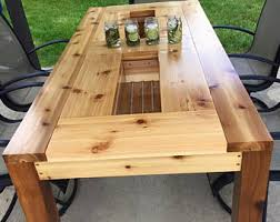 outdoor patio table with built in hidden coolers and