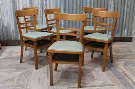 vintage wooden cafe chairs with blue upholstered seats