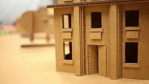 close up view of cardboard house miniature on table stock footage
