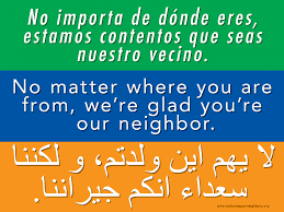 pastor tries to counter anti immigrant rhetoric with welcome signs