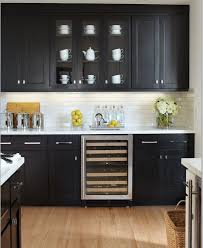 black cabinets white counter white subway tile new home