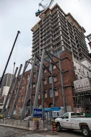 temporary flying buttresses coming down at five condos urban toronto