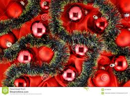 background of red christmas tree balls with gold and green
