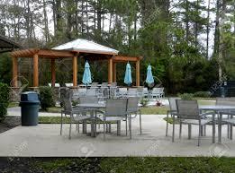 pavilion patio furniture patio furniture with umbrellas on stone patio near upscale condo